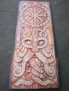 beautiful viking mythology inspired wood carving .