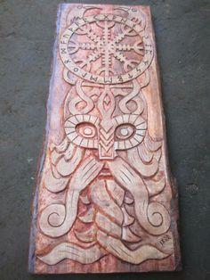 beautiful viking mythology inspired wood carving .
