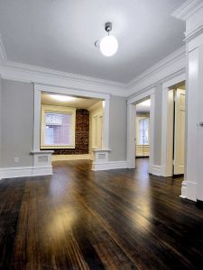 The best warm gray paint colour shown in Open layout with dark wood flooring and brick feature wall. Photo via Chris Nelson Inc floors grey walls The 4 Best Warm Gray Paint Colours: Sherwin Williams Style At Home, Brick Feature Wall, Brick Wall, White Baseboards, Baseboard Trim, Baseboard Styles, Warm Gray Paint, Neutral Paint, Flur Design