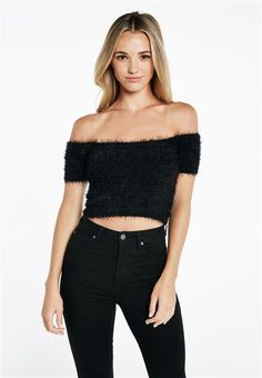 We've got your cool summer days and nights covered with our lightweight knits!The Fluffy Crop features off the shoulder styling, short sleeves and fluffy silhouette with cropped waistline.Pair the look back with a pair of classic denim jeans!Model is wearing a size 10.Fabric Content: 75% Nylon, 25% Acrylic