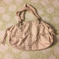 """Rafe New York tan leather studded handbag Rafe New York tan leather studded handbag. This bag is trendy and so cute. Approximately 17""""L x 14""""W when laid out flat. Has some slight wear on bottom and fringe closing a could be cleaned a bit. Overall in great condition! Let me know if I can answer any additional questions! Bundle deals available (I carry various sizes and brands): 2 items 10% off, 3 items 15% off, 4 items or more 20% off  rafe new york Bags Hobos"""