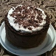 An incredibly moist, rich, triple layer chocolate cake with whipped cream filling and chocolate buttercream frosting.  This was always a favorite in our house!