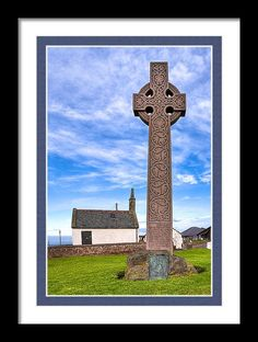 North Berwick Scotland Framed Print featuring Celtic Cross On The Scottish Coast At North Berwick by Mark E Tisdale