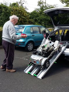 Mr English loading his Quingo Flyte mobility scooter