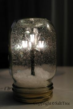 Model dollhouse streetlight + Mason Jar (http://ow.ly/9HizQ) + fake snow and glitter = A Beautiful Christmas Scene!