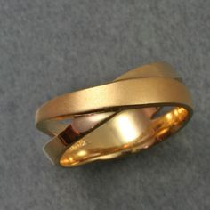Hey, I found this really awesome Etsy listing at https://www.etsy.com/listing/56568903/overlap-band-a-wedding-band-in-14k
