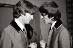 """John and George enjoying an intimate moment over a glass of milk."""