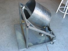 Deburring Tumbler - Homemade deburring tumbler constructed from square tubing, a sheetmetal drum, pillow bearings, gears, chain, and an electric motor.