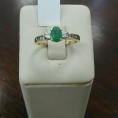 14k yellow gold emerald&diamond ring 14k stamped inside of ring. 0.35ct genuine Emerald on the center, 0.25ct diamond. Comes with appraisal for insurance purposes. Brand new Jewelry Rings