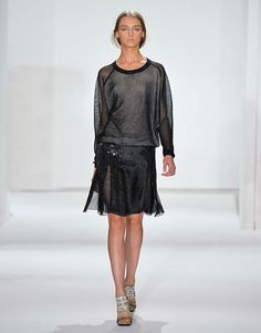 Reek Krakoff Spring 2012.  Sheer is big this year, but I could see myself wearing it as accents in items such as this sweater and skirt.  I firmly believe there is such a thing as to much sheer.