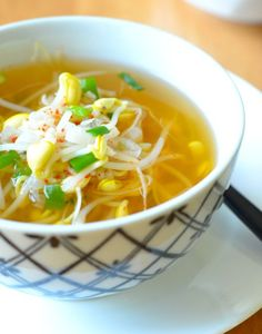 Wonderfully warm and light - this amazingly soothing soup is Koreans' Chicken Soup for the soul. If you get a terrible cold, this soybean sprout soup is what mom will make for you - with extra red ...