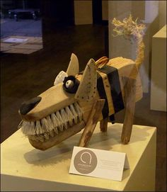 Wacky recycled object dog...can't tell who made him.