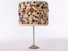 Lampshades made from antique buttons Just a border... Maybe a fringe sewn on the edge