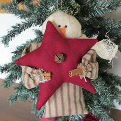 Snowman with Red Star www.teeliesfairygarden.com This snowman got the red star from a fairy and he loves it so very much! #fairysnowman