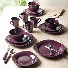 Purple dishes! The kitchen walls are sagey green; eggs/greens etc. look great on these.