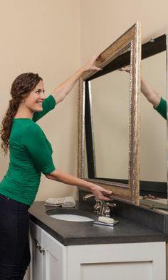 The mirror never leaves the wall. Just assemble and press the pre-taped frame right onto the glass.