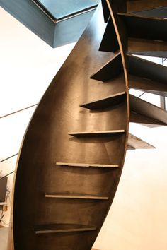 3 of Art becomes functional with this stunning architectural staircase design, created by Italian company Sandrini Scale. The helix-shaped metal structure is formed by blending two spirals; one outside and one inside serving as a rigid support for the Architecture Details, Interior Architecture, Escalier Design, Balustrades, Stair Handrail, Railings, Take The Stairs, Modern Stairs, Architects