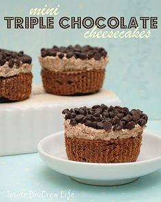 Mini Triple Chocolate Cheesecakes - chocolate cheesecake topped with a chocolate mousse and mini chocolate chips.  http://www.insidebrucrewlife.com