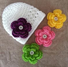 Crochet baby girl beanie hat with 4 interchangeable flowers on Etsy, $11.00
