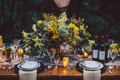 Oranges, culinary herbs, vines, and olive branches centerpiece by Melanie Benson Floral
