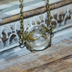 Make a Wish: Real Dandelion Seed Glass Orb / Globe pendant Vintage bronze Necklace - Childhood Memories Blowing Dandelion, Make A Wish, How To Make, Globe Pendant, Organza Gift Bags, Glass Globe, Bead Caps, Jewelry Findings, Dandelion Seeds
