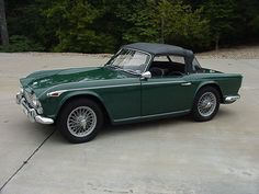 """Triumph TR4 1967.  Saw this on the street a little while ago...haven't seen one in over 20 years...rolled down my window and asked the driver """" '67 TR4?""""  He was surprised that I knew that...but I've had a little crush on the Triumphs for a long time!"""
