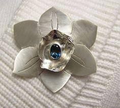 Custom Apa Design Silver Flower Brooch and Pendant with Blue Topaz. Gemstone Brooch, Gemstone Rings, Brooches Handmade, Handmade Jewelry, Silver Flowers, Flower Brooch, Fine Jewelry, Jewellery, Blue Topaz