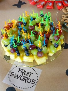 display of fruit for pirate party, really cute idea to use tiny swords for fruit kabobs for pirate party