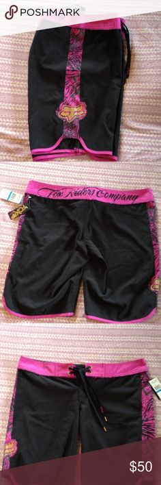 Fox Racing Boardshorts Juniors size 9 NWT Long boardshorts with fox head on one side. I do NOT trade or hold items. Fox Swim