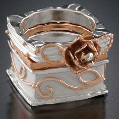 Stack of 3 rings sterling silver, 14k rose gold, diamond