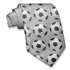 $32.35 Soccer Ball Tie. Known as Soccer or Football, this sport is popular world wide! Subtle grey tie with little soccer balls. Great tie for a coach, player or fan!