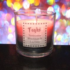 Bright pink bubblegum tops this candle, much like the pink hair that tops Tonks' visage. The middle layer is the enchanting scent of the wolfsbain that allows her to spend her days in the company of the love of her life, Remus. The bottom layer is the scent of rich suede leather. Soft and to...