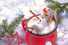Photo about Red mug with hot chocolate with melted marshmallow snowman. Image of seasonal, gourmet, marshmallow - 62395075