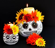 These Day of the Dead sugar skull pumpkin candle holders are easy to make and perfect to decorate an altar or as a Dia de los Muertos centerpiece or a Halloween Party .