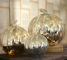 Pottery Barn Mercury Glass Pumpkins. 2010 Fall.........or decorate real pumpkins with reflective glass spray paint!