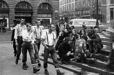 A clash of two worlds in London; skinheads and hippies. Circa 1969