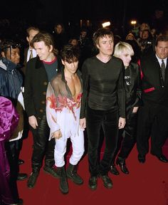Members of the band Duran Duran arrive for their opening night performance at New York's Fashion Cafe, April 7, 1995. From left: John Taylor, Roger Taylor, Simon Le Bon, and Nick Rhodes. (AP Photo/Adam Nadel)