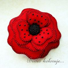 red poppy .... felt flower brooch by Anna Zaprzelska ... buttonhole stitched edges ... black seed beads ... gorgeous!