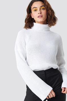 b17ae0b047b The Dropped Shoulder Polo Knit by Emilie Briting x NA-KD features a relaxed  knit