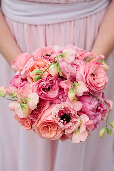 A Romantic Garden Wedding With The Perfect Homemade Touch  #refinery29  http://www.refinery29.com/martha-stewart-weddings/4#slide3  Amanda carried a clutch of peonies, roses, ranunculus, and sweet peas in soft pink tones.  Florist: Days Gone By Florists.