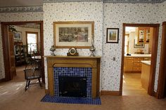 fireplace mosaic with doors to kitchen and dining room