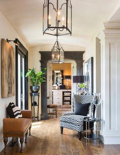 Joy Tribout Interior Design Love entry hall to have seating for visitors