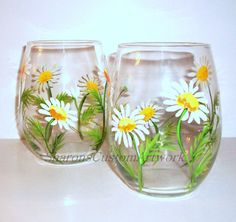 These are beautiful hand painted 20 oz. stemless wine glasses that I designed and hand painted. They are beautiful springtime white daisies