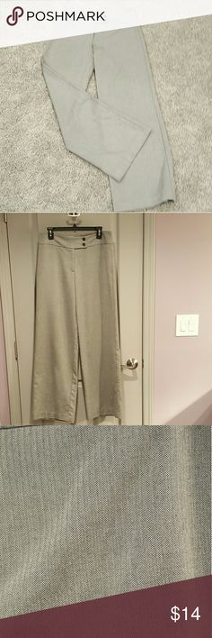 """Lily Bleu Wide Leg Trousers On trend wide leg pants in a lighter weight fabric. Chic herringbone print in black/white weave that looks light gray from a distance (color best in pic 2). Pair with solid tops or mix with a print top for a very """"Spring 2017""""  look. Stretch added for comfort and to accommodate curves.  Has a small black dot on right leg (Pic 3) that almost blends in. Priced accordingly  60% polyester, 32% rayon, 8% spandex.  Approx. 32.5"""" inseam, 10.5"""" rise, 16.5"""" across waist…"""