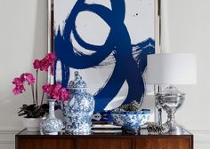love the blue and white porcelains with a contemporary painting backdrop