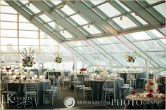 Timeless and elegant spring wedding at the Adler Planetarium included beautiful floral arrangements such as white hydrangea, fuschia stock, white callas, white-fuschia orchids & fuschia tulips. Photos by www.briankinyon.com/