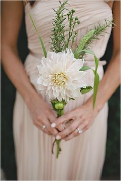 Simple bridesmaid bouquet with a single dahlia bloom. Bouquet by Flowers by Lani. Photo by Amanda Doublin (via Wedding Chicks).