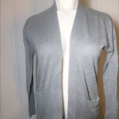 """Make Offer - Grey Cardigan w/ Front Pockets - NWT Grey Cardigan w/ Front Pockets - New With Tags. Perfect to wear over short sleeves or sleeveless items and throw on when a little chilly. Made of 55% cotton, 20% polyester, 15% acrylic and 10% rayon...machine washable. Stretchy...measurements done laying flat without stretching: 22"""" across upper back shoulders, 28"""" in length and 18"""" sleeves. No trades but feel free to make an offer or ask for bundle pricing. Sonoma Sweaters Cardigans"""