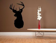 Deer head silhouette by WallDecalsAndQuotes