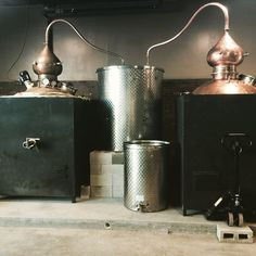 Our two Hoga copper pot stills, with the water condenser in the middle. This was right after set up in our new locale. Sonoma County Distilling Company.